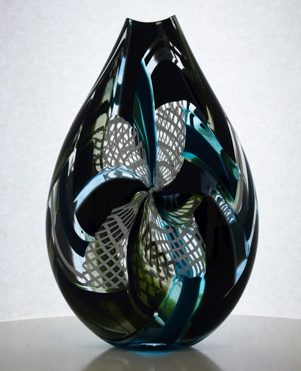 Hand blown art glass vase featuring black and white stripes highlighted with blue.