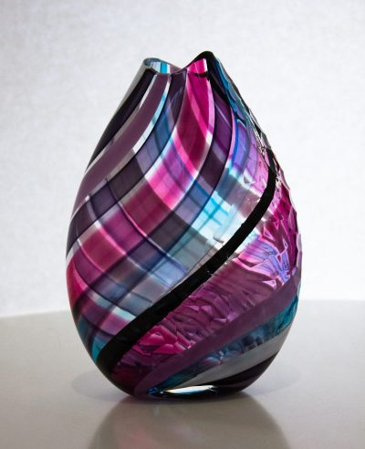 Lovely pink purple and blue flat vase with carving on the surface