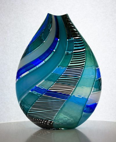 Blue and black striped hand blown glass flat vase with carving