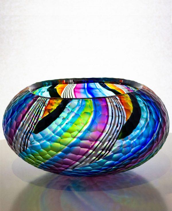 Amazing multi colored bowl with green, blue, purple and black stripes. includes extensive carved patterning on the outside.