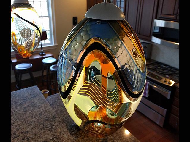 carved egg pendants