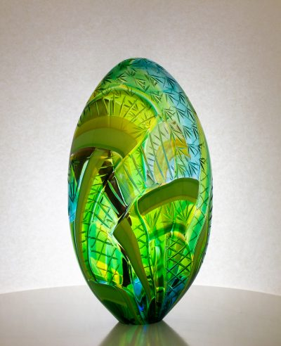 Wonderful green striped hand blown glass egg sculpture with carving on the exterior.