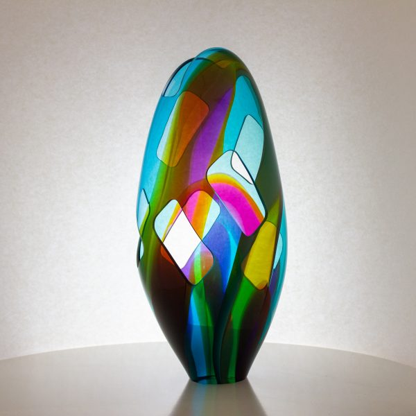 Gorgeous purple and blue blown glass egg with rectangular cutouts.
