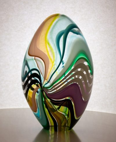 Hand blown glass egg with neutral colored stripes.