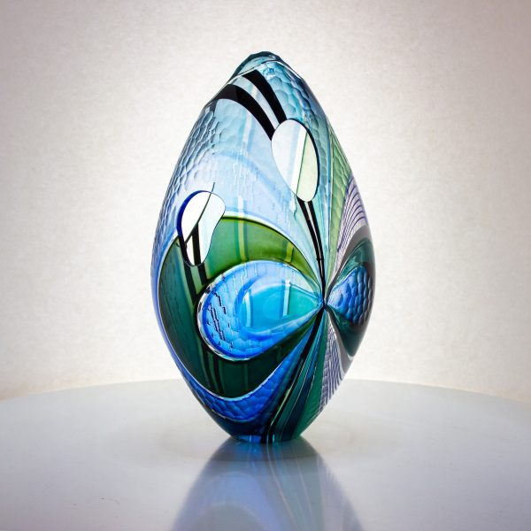 Gorgeous blue striped hand blown glass egg with oval cutouts.