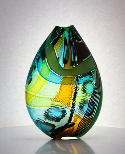 Amazing hand blown vase in greens, with textured carving on the surface.