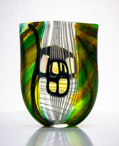 Gorgeous flat glass vase with greens and white.