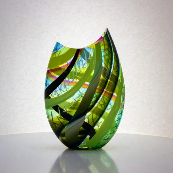 Bright green and yellow striped hand blown glass vase with carving on the surface