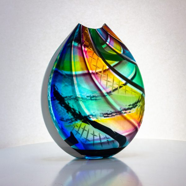 Wonderful multi colored flat vase with carving on the surface