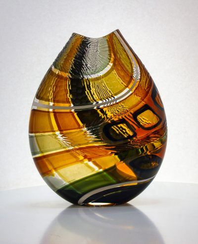 Gorgeous amber and brown striped vase with carving on the exterior.