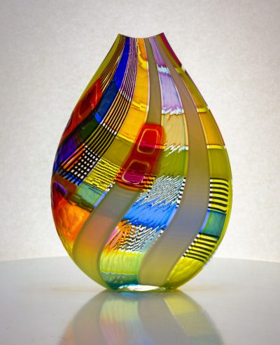 Glorious yellow striped hand blown glass vase with carved texture on the outside.