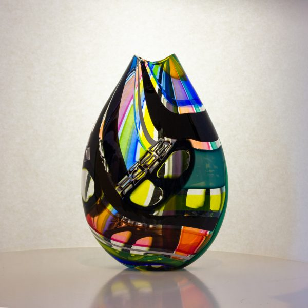 Fun hand blown flat vase with multi colored stripes and black squares.