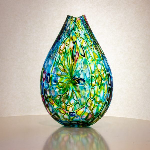 Green and blue hand blown flat glass vase.